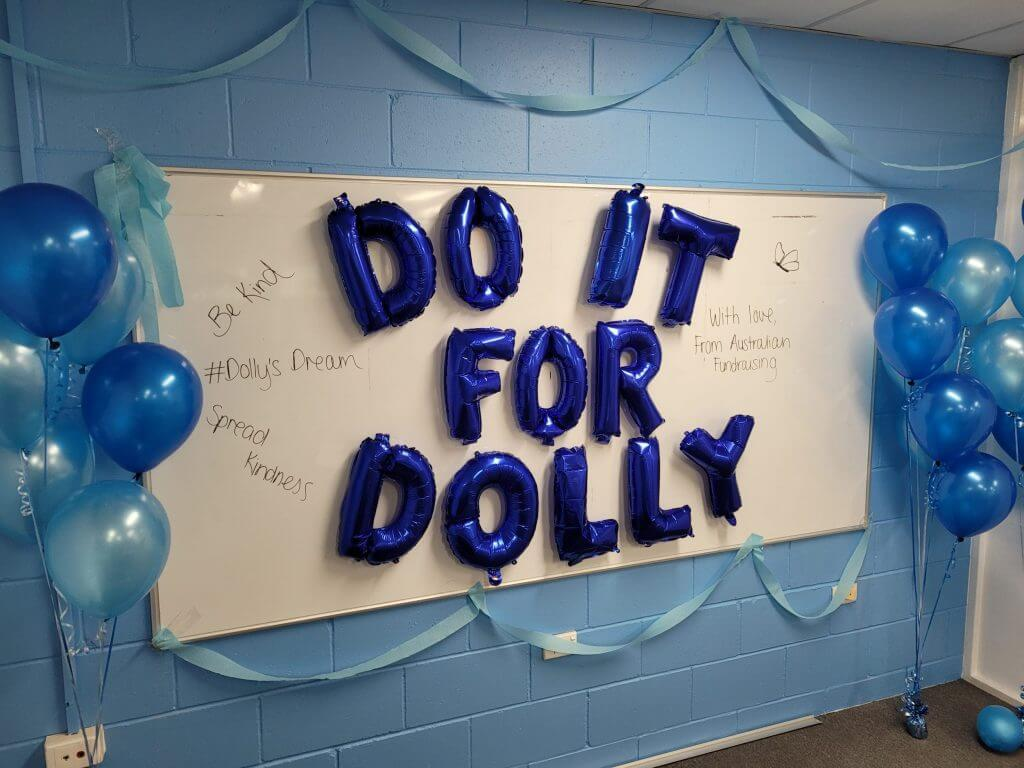 Do it for Dolly Day sign in the Australian Fundraising office.