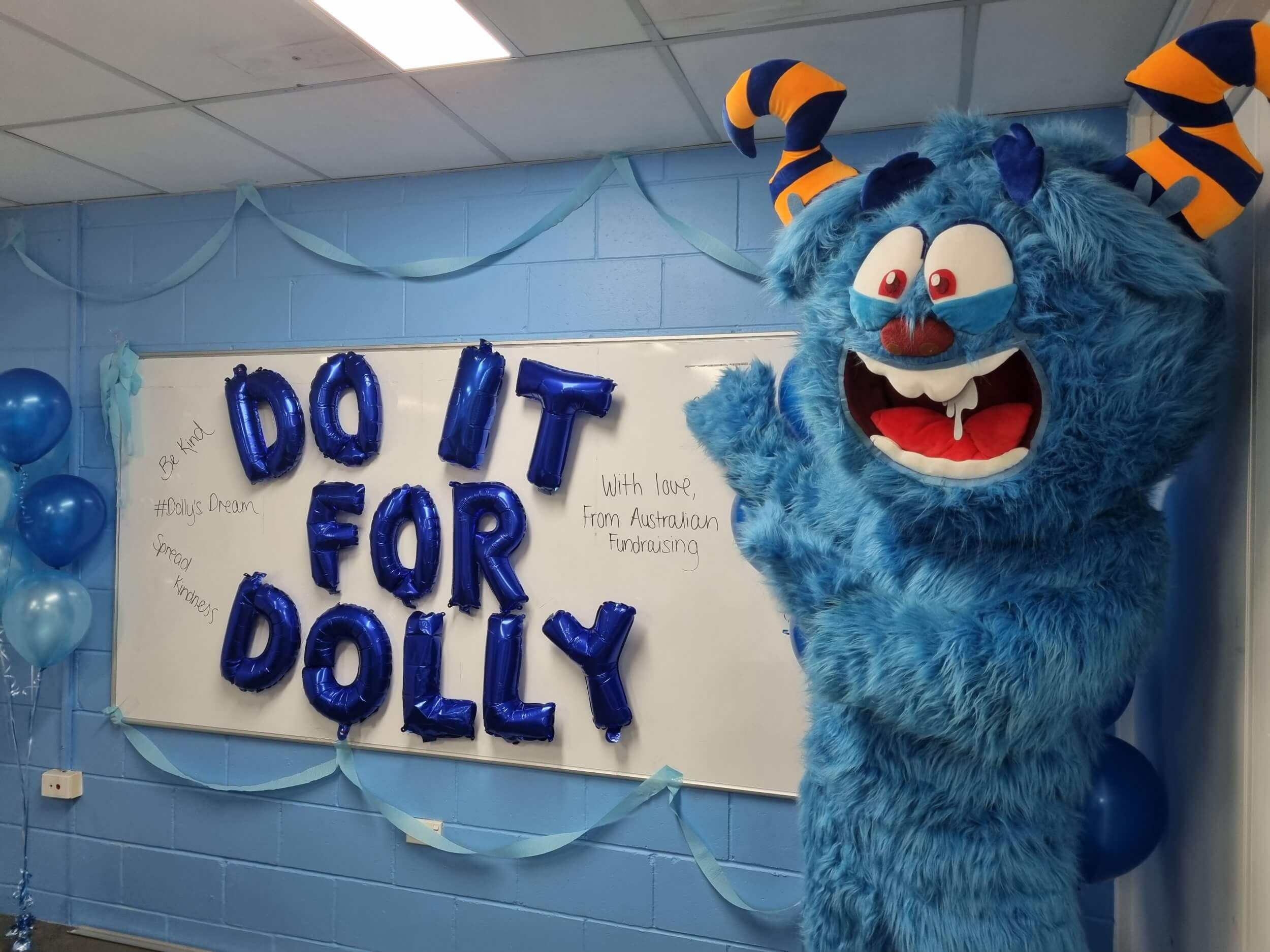 Even our Monster got in on the action for Do it for Dolly Day!